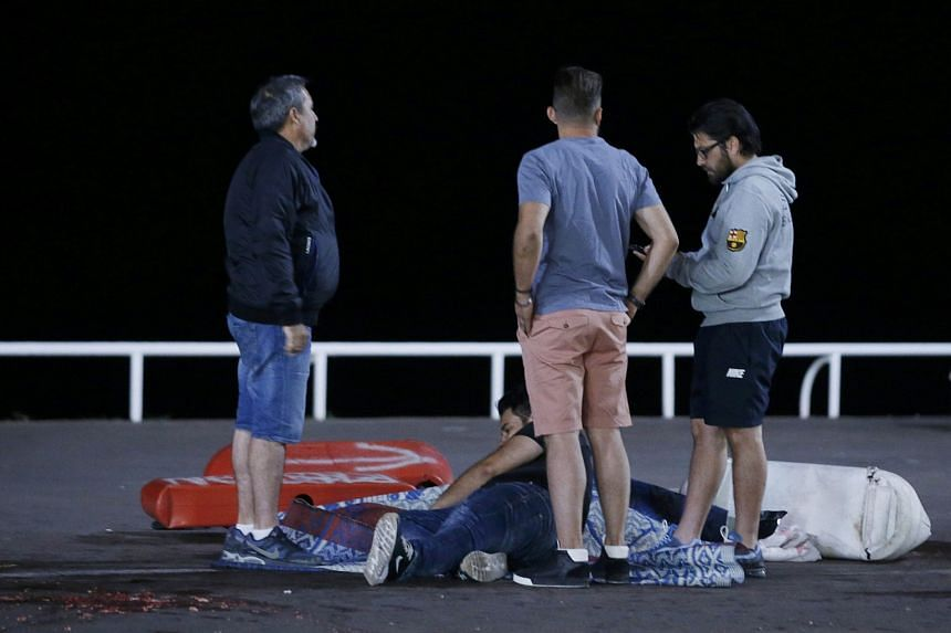 An injured person seen on the ground after dozens were killed in Nice, France, when a truck ran into a crowd celebrating the Bastille Day national holiday on July 14.