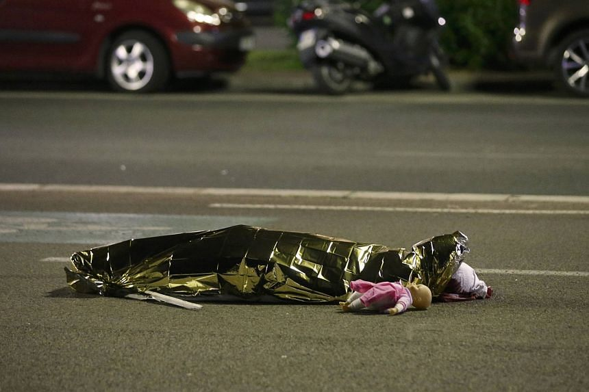 A body is seen on the ground July 15 after several people were killed in Nice, France, when a truck ran into a crowd celebrating the Bastille Day national holiday July 14.