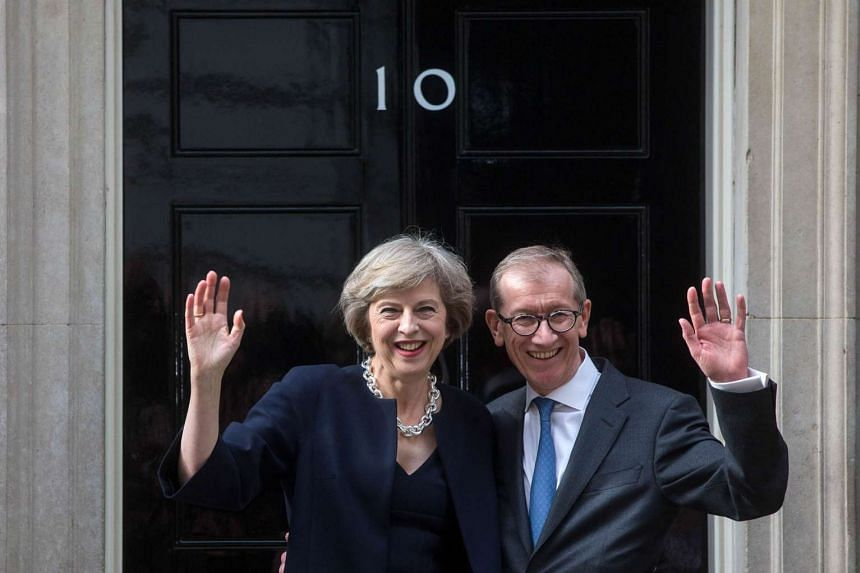 British Prime Minister Theresa May and her husband Philip May, outside 10 Downing Street in London on July 13, 2016.