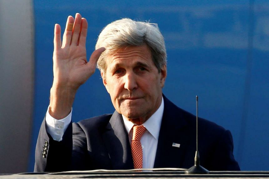 US Secretary of State John Kerry waves before getting into a car on his arrival in Moscow on July 14, 2016.