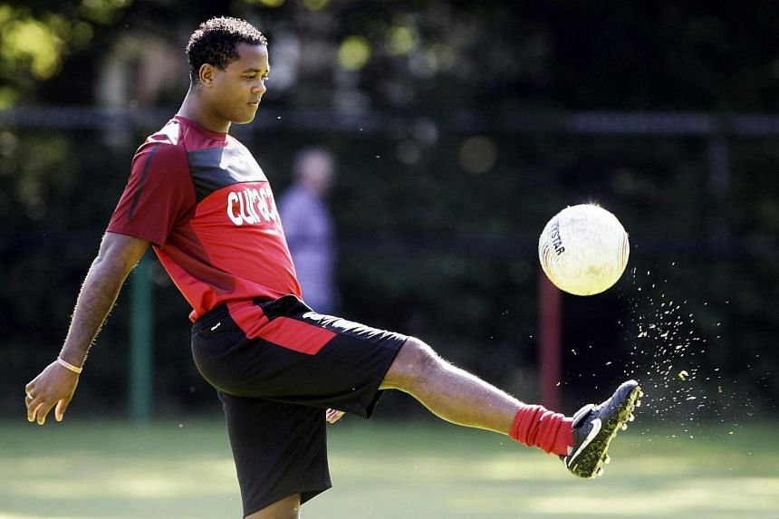 Former Dutch player Patrick Kluivert playing with the ball during the training of the Dutch football club NEC.