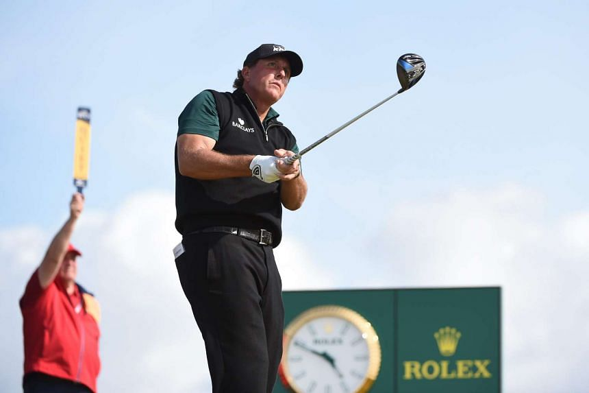Phil Mickelson of the US tees off during the first day of the British Open Golf Championship.