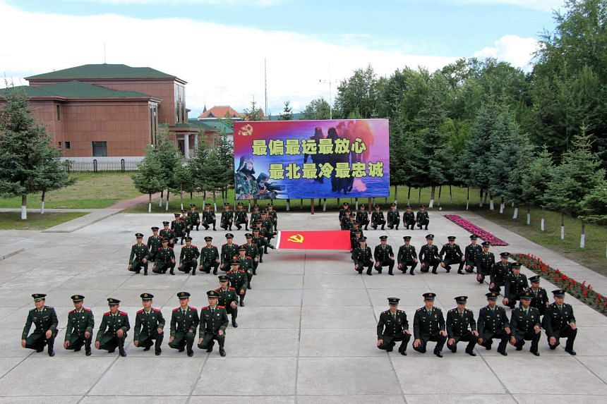 Chinese soldiers marking the Communist Party's 95th anniversary in Heilongjiang province last month. In President Xi's address, he said China will never compromise on its sovereignty. Standing up forcefully on the world stage has become a cornerstone of t