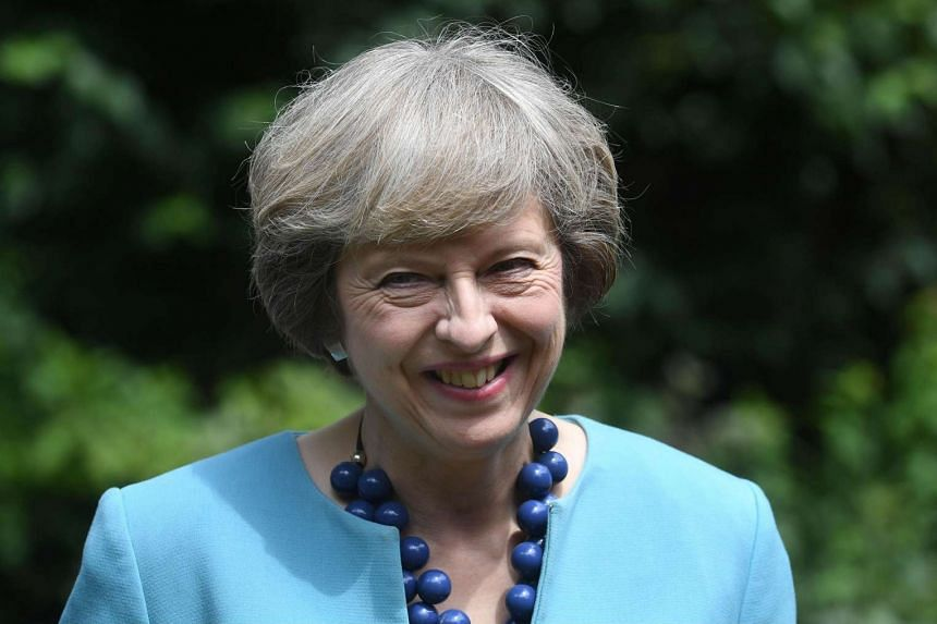 British Prime Minister Theresa May hosts a reception for the Police Bravery Award in the garden of 10 Downing Street in central London on July 14.