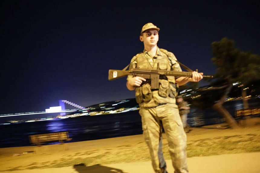 A Turkish soldier stands on guard on the side of the road on July 15, 2016 in Istanbul, during a security shutdown of the Bosphorus Bridge.