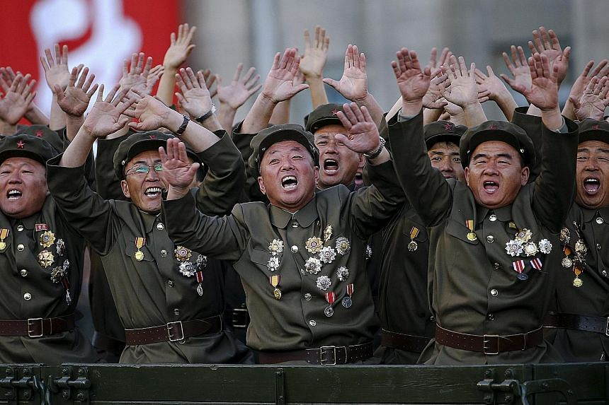 Veteran soldiers cheering as their truck drove past Mr Kim's stand at a parade held in Pyongyang last year to celebrate the 70th anniversary of the founding of the Workers' Party.