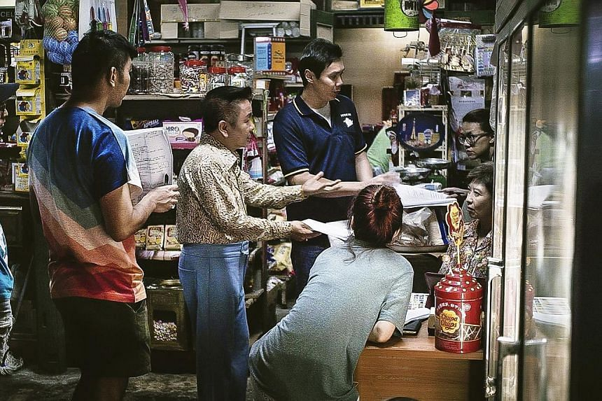 Left: Royston Tan (centre) with his aunts, grandmother and younger brother (right) at the family's provision shop in Lorong Chuan. Above: Tan's new telemovie, The Provision Shop.