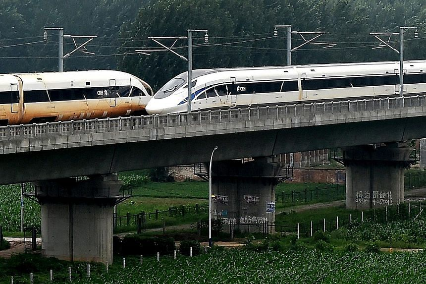 """Two Chinese trains dashing at 420kmh in opposite directions passed each other on parallel tracks yesterday, in the latest feat achieved by China in high-speed rail. At about 11.20am, the two trains, """"Golden Phoenix"""" and """"Dolphin Blue"""", crossed on lin"""