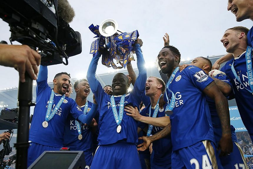 N'Golo Kante lifting the trophy with his Leicester City team-mates as they celebrate winning the English Premier League last season.