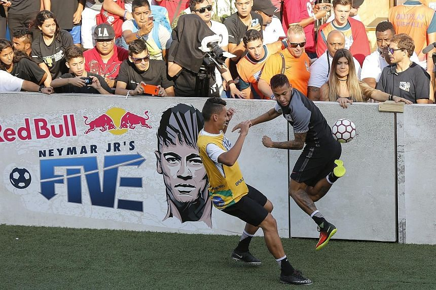 Neymar (right) playing in an exhibition match after the final of the Neymar Jr Five tournament in his hometown of Praia Grande. The football gold is one of the most coveted by the Olympic hosts.
