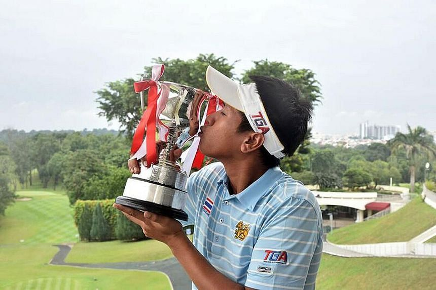 Kammalas Namuangruk savours success with the Singapore Open Amateur trophy. He also secured a spot in next year's SMBC Singapore Open.