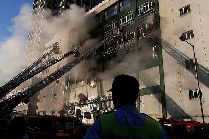 A burning industrial building in Hong Kong on June 23. The fire burned for 108 hours, killing two firemen. Demand for storage facilities in space- constrained Hong Kong has caused the storage trade to grow by about 41 per cent in the past three years