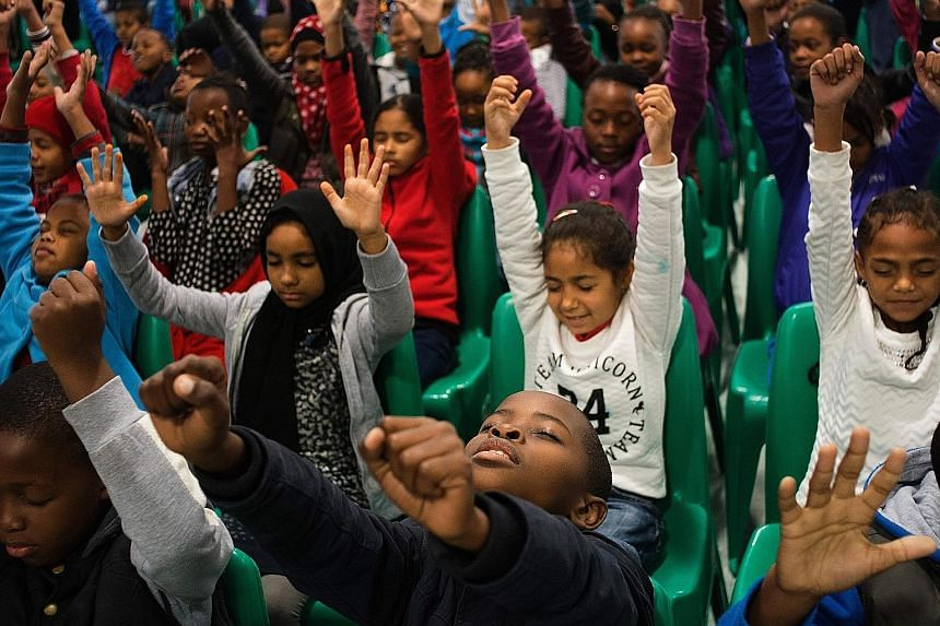 Pupils from a school in Bonteheuwel, a township in South Africa, taking part in a free meditation class. Gang violence in the region often keeps youngsters out of school. Activities like meditation are thought to help these children deal with their h