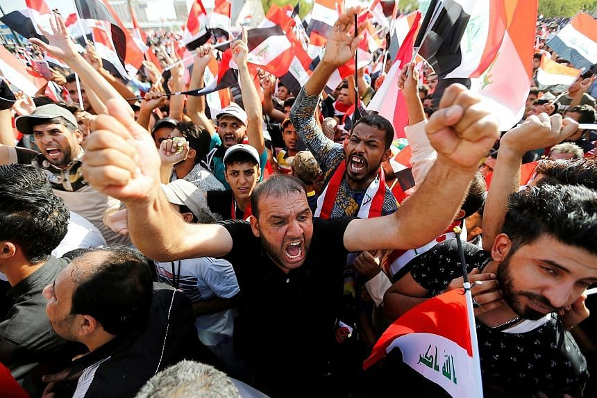 Supporters of populist cleric Moqtada Al-Sadr shouting slogans during a protest in Baghdad's Tahrir Square. The cleric had called for the dismissal and trial of corrupt officials and an end to sectarianism in the government. Previous protests had res