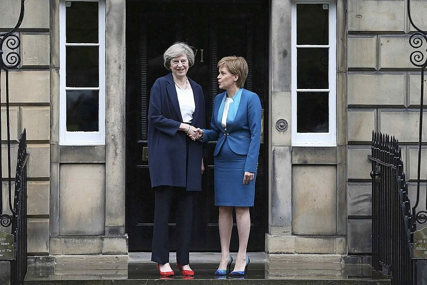 Mrs May (far left) greeting Scottish First Minister Sturgeon in Edinburgh, Scotland, in her first foray out of London since becoming the British Prime Minister. Ms Sturgeon said if Scots wanted another independence vote, the British government would