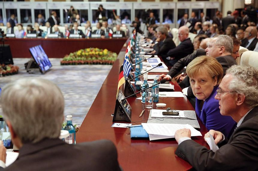German Chancellor Angela Merkel (second right) and other leaders attending the Asia-Europe Meeting (ASEM) summit in Ulan Bator, Mongolia, on July 15.