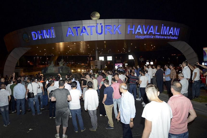A crowd forms in front of a Turkish armoured vehicle at Ataturk airport in Istanbul, Turkey on July 16.
