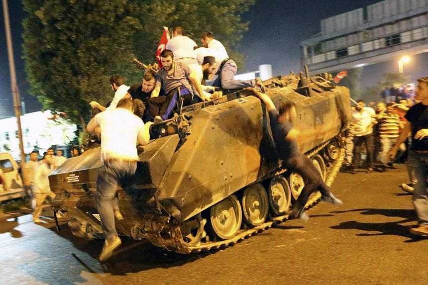 People falling off a tank in Istanbul, Turkey, during the coup attempt on July 16.