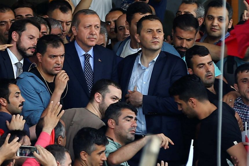 Erdogan is seen amid his supporters at Ataturk Airport in Istanbul, Turkey July 16, 2016.