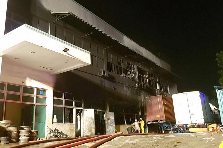 Warehouse fire at Sungei Kadut Crescent took 60 firefighters about three hours to put out on July 16, 2016.