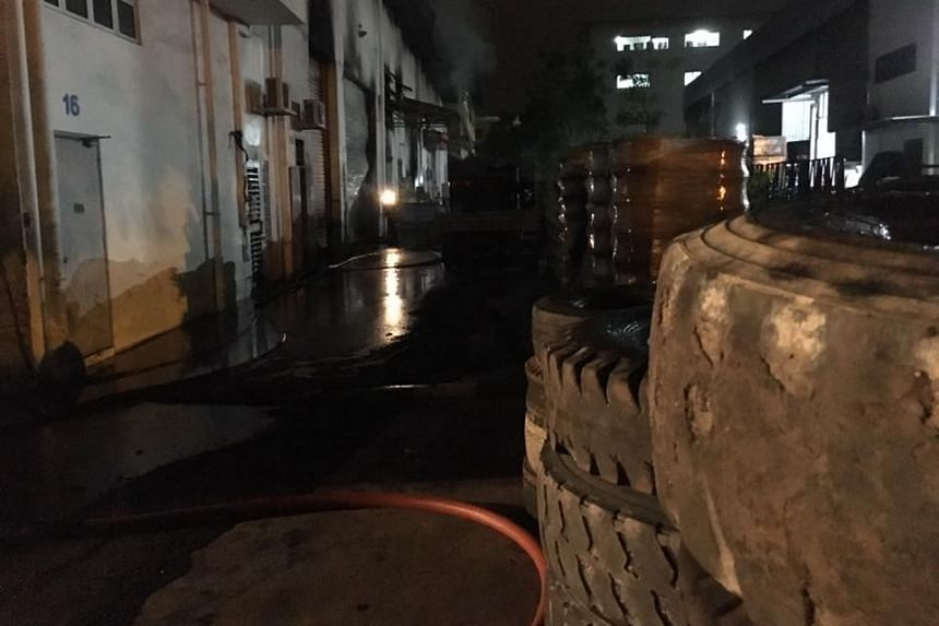 Heavy vehicles tyres caught fire at a warehouse at Sungei Kadut Crescent. The blaze took 60 firefighters about three hours to put out on July 16, 2016.