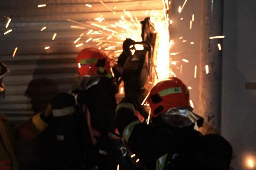 A total of 60 firefighters took about three hours to put out a fire at a Sungei Kadut warehouse on July 16, 2016.