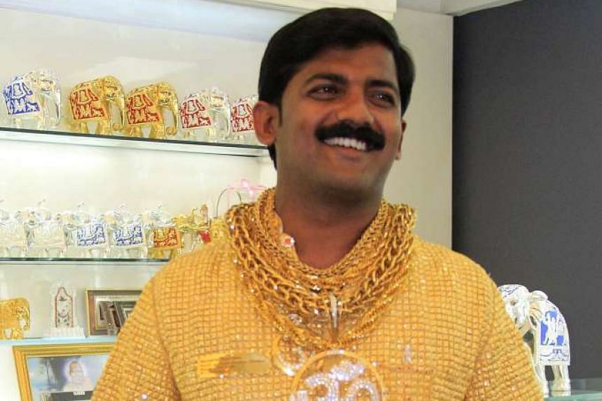 Indian businessman Datta Phuge poses for a photograph wearing a shirt made of gold in 2013.
