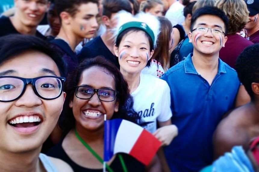 Singaporean Mr Huang Jing Jie (far left), 23, a student at the Singapore University of Technology and Design, at a football match in France with his friends the week before the Bastille Day attack happened.