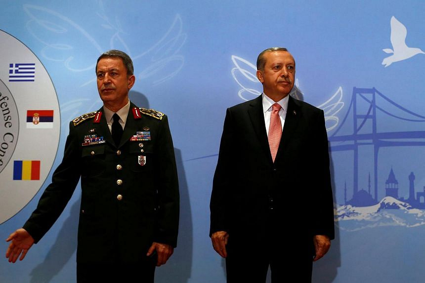 Turkish President Tayyip Erdogan (right) is seen with Chief of Staff General Hulusi Akar during the Balkan Countries Chiefs of Defence Conference in Istanbul, Turkey, on May 11.