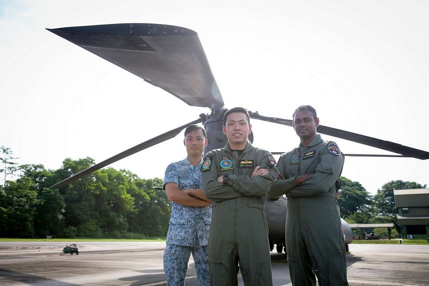 (Left to right) ME3 Ng Woon Chye, overall-in-charge for State Flag Team, LTC Liao Ming Hao, Ch-47D Chinook helicopter pilot, 2WO Vijaikumar, Aircrew Specialist.