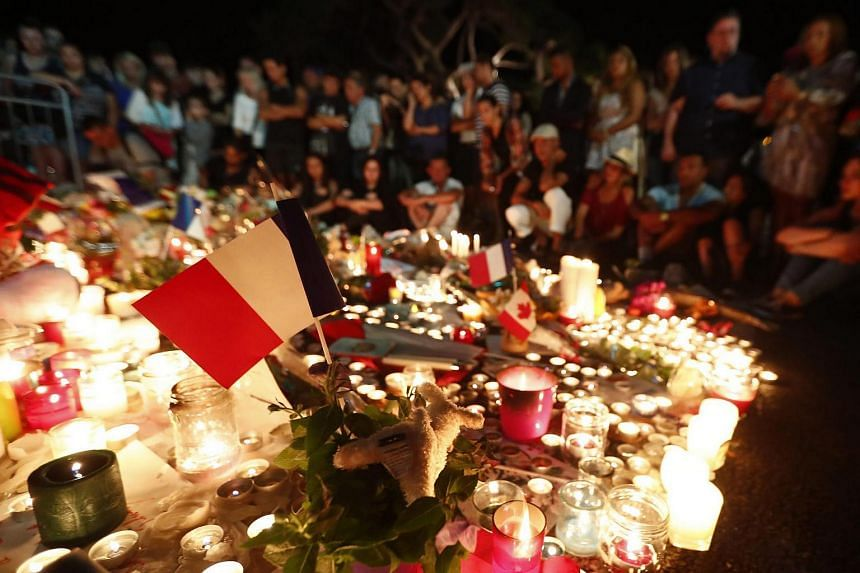 People gather at a memorial at the 'Promenade des Anglais' where the truck crashed into the crowd during the Bastille Day celebrations, in Nice, France, on July 16.