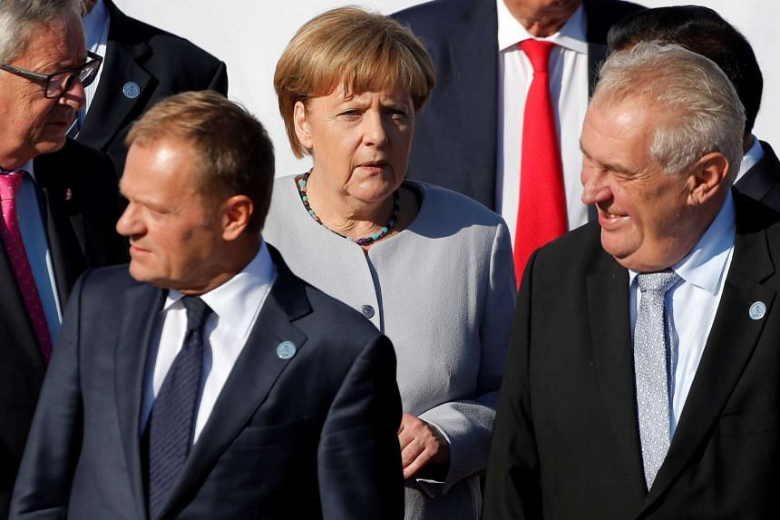 Merkel arrives for a family photo during the Asia-Europe Meeting summit just outside Ulaanbaatar, Mongolia, July 16, 2016.