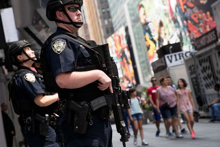 New York City police stand guard in Times Square, on July 15, 2016.