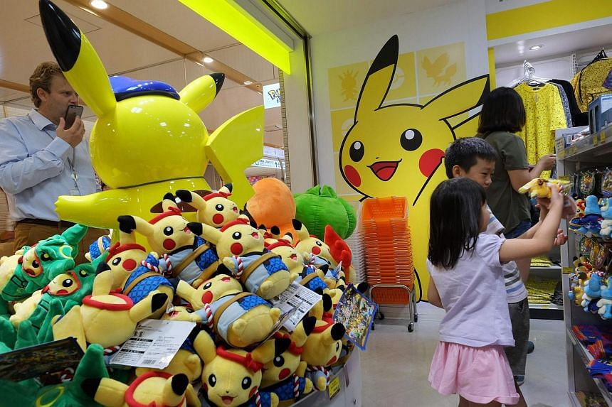 Customers visit a shop selling Pokemon goods.