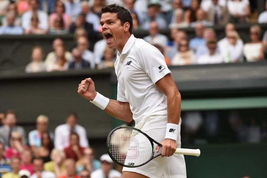 Raonic in action against Switzerland's Roger Federer at the Wimbledon tennis tournament in London on July 8, 2016.