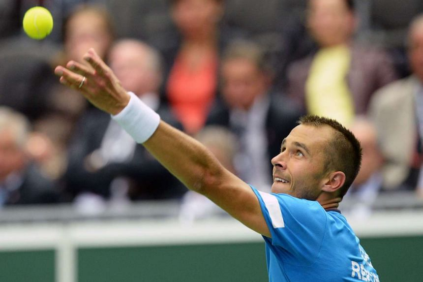 Lukas Rosol of the Czech Republic serves the ball to Jo-Wilfried Tsonga of France during the Davis Cup quarter-final.