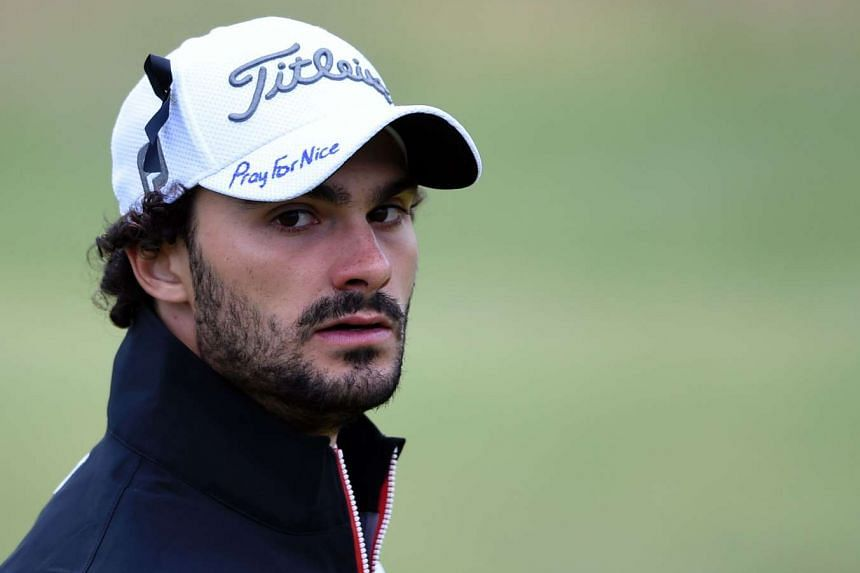 "France's Clement Sordet wears a black ribbon on his cap with the slogan ""Pray For Nice"" written on the peak at the British Open Golf Championship."