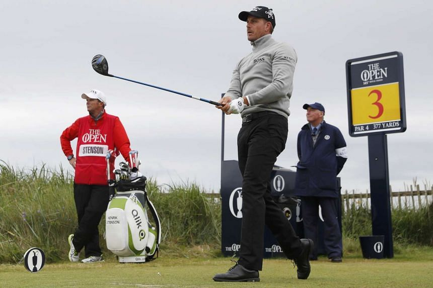 Stenson watches his tee shot on the third hole during the third round.