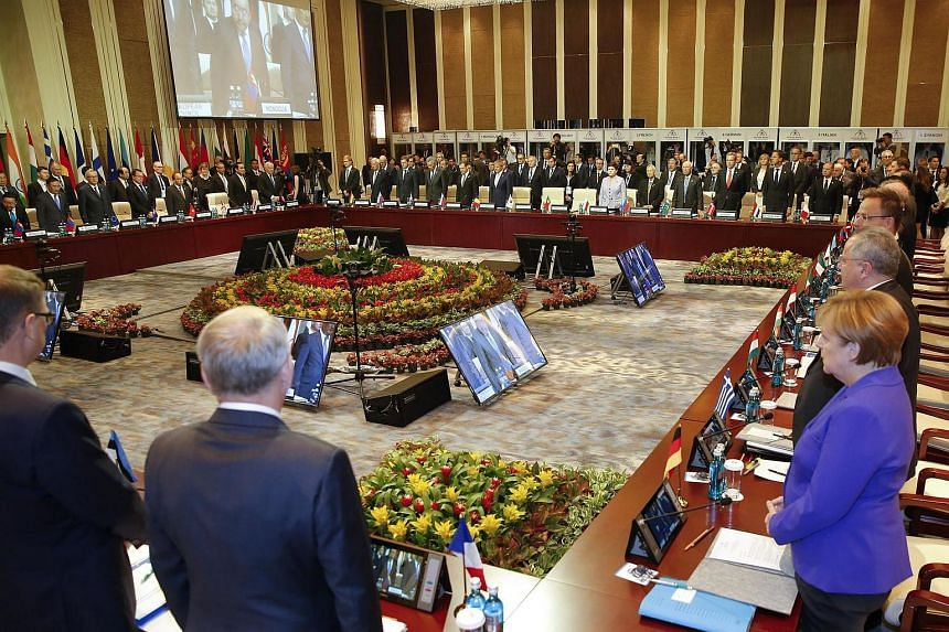 Leaders stand for a minute of silence for the victims of the Bastille Day attack, at the 11th Asia-Europe Meeting (ASEM) Summit in Ulan Bator, Mongolia on July 15.