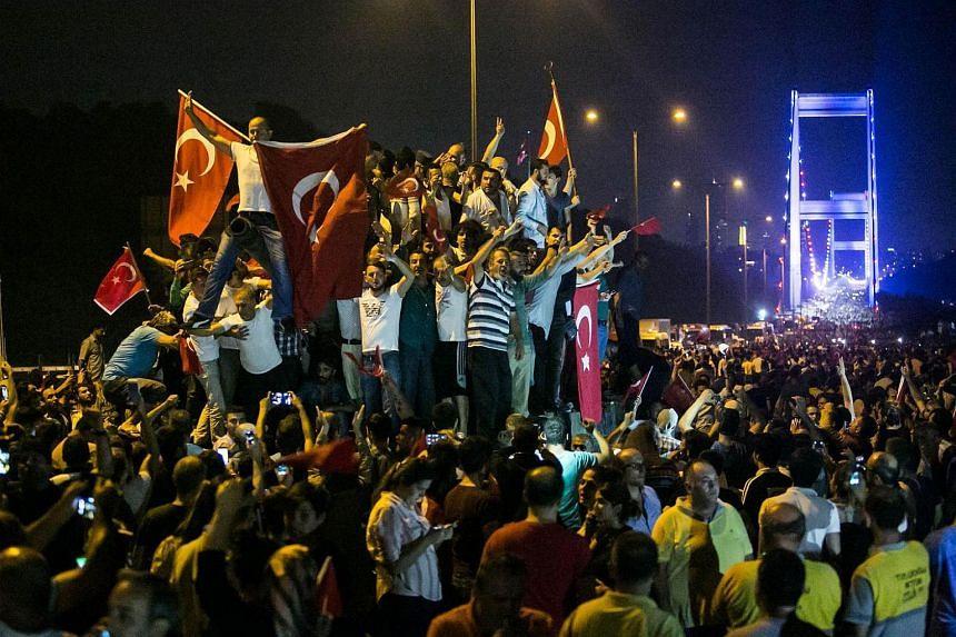 People demonstrate near the Fatih Sultan Mehmet bridge in Istanbul on July 16.