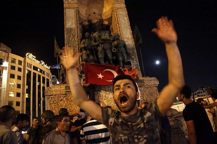 A supporter of Recep Tayyip Erdogan shout slogans at the Taksim Square in Istanbul, Turkey, on July 16.