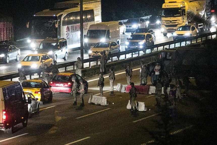 Turkish military control a road in Istanbul on July 16 after Turkish troops launched a coup.