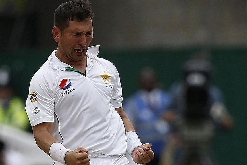 Pakistan's Yasir Shah celebrates taking the wicket of England's James Vince (left) for 16 runs during the cricket match between England and Pakistan on July 15.