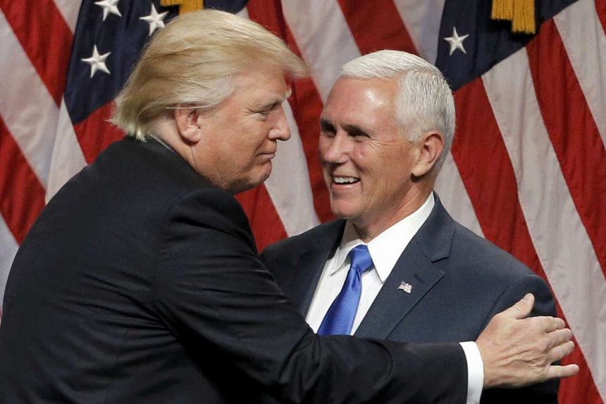 Trump (left) embraces Pence after introducing the Indiana governor as his vice-presidential running mate on  July 16, 2016.