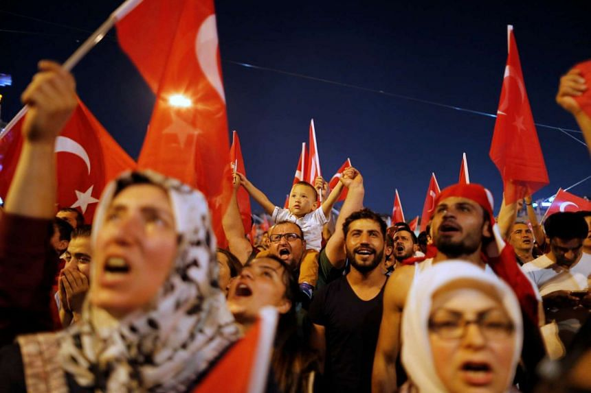 Supporters of Turkish President Tayyip Erdogan gather at Taksim Square in central Istanbul, Turkey, July 16, 2016.