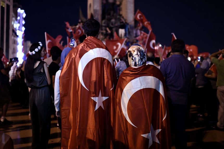 Pro-Erdogan supporters gather at Taksim square in Istanbul to support the government on July16, 2016, following a failed coup attempt.
