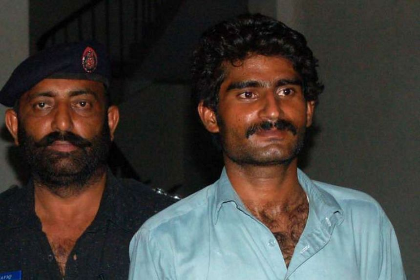 Muhammad Waseem (right), the brother of slain social media celebrity Qandeel Baloch, is escorted by police following his arrest for Qandeel's death in Multan early on July 17, 2016.