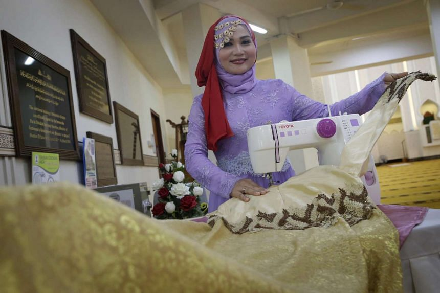 Indonesian domestic worker Asih, who has picked up sewing skills through Mujahidah Learning Centre, at the Mujahidin Mosque on July 17, 2016.