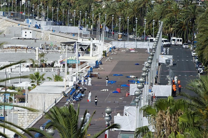 Crime scene investigators at work on the Promenade des Anglais in Nice, France, after Tunisian-born Frenchman Mohamed Lahouaiej-Bouhlel, 31, ploughed a truck into a crowd celebrating Bastille Day last Thursday.