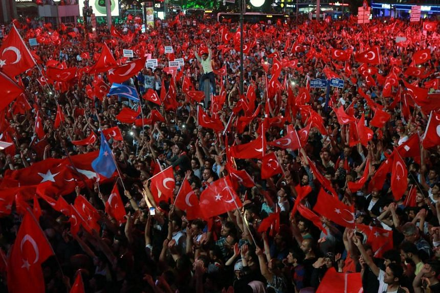 People wave flags in Kizilay Square in Ankara on July 16 during a demonstration, in support of Turkish President Recep Tayyip Erdogan.